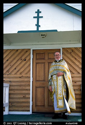 Orthodox priest ouside the old Russian church. Ninilchik, Alaska, USA (color)