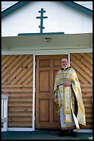 Orthodox priest ouside the old Russian church. Ninilchik, Alaska, USA