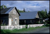 White picket fence and wooden houses. Hope,  Alaska, USA ( color)