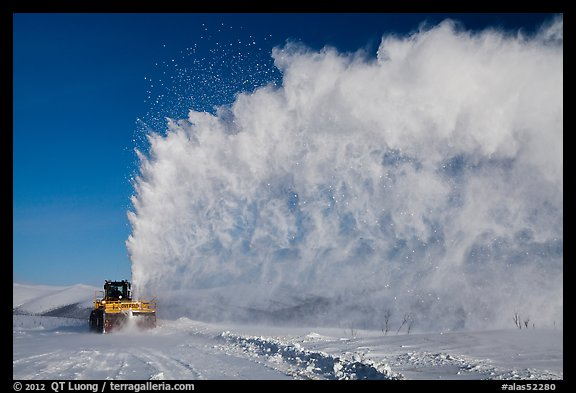 Snow plow truck with cloud of snow. Alaska, USA (color)