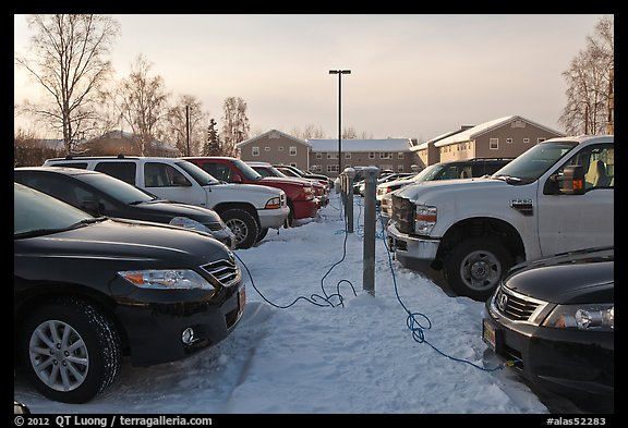 Cars with block engine heaters connected to plugs. Fairbanks, Alaska, USA (color)