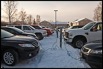 Cars with block engine heaters connected to plugs. Fairbanks, Alaska, USA ( color)