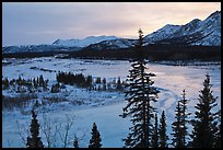 Winter landscape with frozen river at sunset. Alaska, USA (color)
