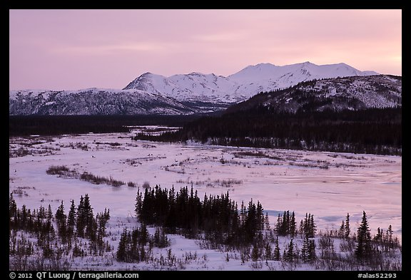 Frozen river and mountains at sunset. Alaska, USA (color)