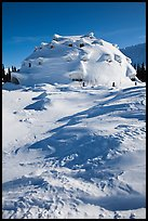 Igloo-shaped building covered with snow. Alaska, USA (color)