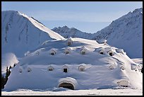 Snow-covered dome-shaped building. Alaska, USA (color)