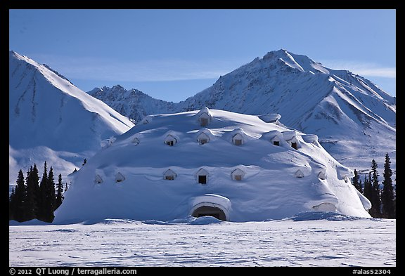 Snowy dome-shaped building and mountains. Alaska, USA (color)