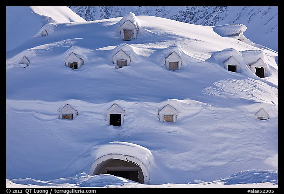 Snow-covered igloo-shaped building. Alaska, USA (color)
