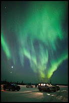 Northern Lights dance above snowy parking lot. Alaska, USA ( color)