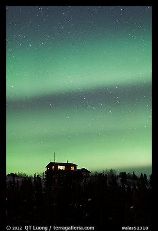 Hilltop house and Aurora Borealis. Alaska, USA (color)