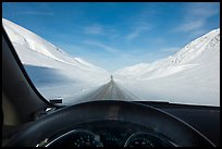 Road in wintry landscape seen from dashboard indicating -32F temperature. Alaska, USA (color)