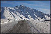 Frozen James Dalton Highway below Arctic Mountains. Alaska, USA ( color)