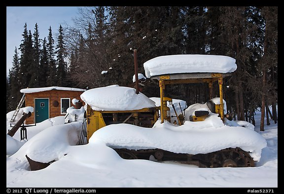 Machinery covered in snow. Wiseman, Alaska, USA