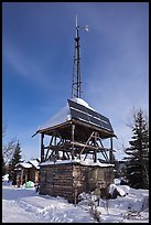 Tower with solar panels and windmill. Wiseman, Alaska, USA (color)