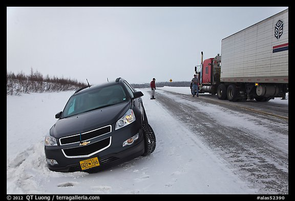 Car stuck in snow along Dalton Highway. Alaska, USA (color)