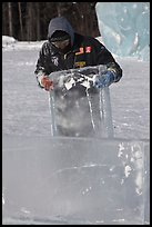 Ice carver lifting ice block. Fairbanks, Alaska, USA ( color)