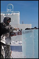 Sculptor using electric saw to carve ice. Fairbanks, Alaska, USA (color)