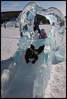 Children slide through ice sculpture. Fairbanks, Alaska, USA (color)
