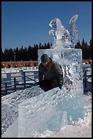 Girl on ice sculpture, George Horner Ice Park. Fairbanks, Alaska, USA (color)
