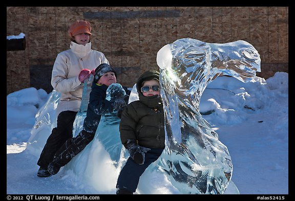 Family riding camel carved out of ice. Fairbanks, Alaska, USA (color)
