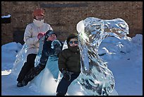 Family riding camel carved out of ice. Fairbanks, Alaska, USA ( color)
