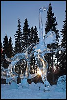 Sun setting over ice sculpture, World Ice Art Championships. Fairbanks, Alaska, USA (color)