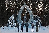 Visitors looking at ice sculpture, 2012 World Ice Art Championships. Fairbanks, Alaska, USA ( color)