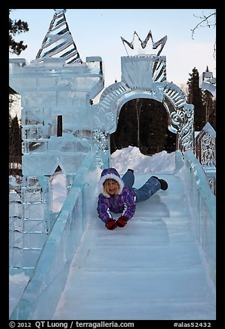 Girl on ice slide, Ice Alaska. Fairbanks, Alaska, USA (color)