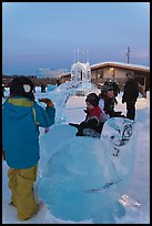 Children playing on ice sculptures, Ice Alaska. Fairbanks, Alaska, USA (color)