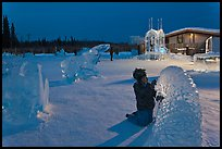 Child amongst ice sculptures at dusk. Fairbanks, Alaska, USA ( color)