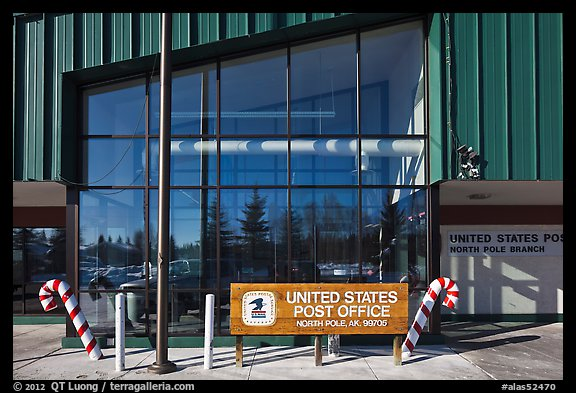 Post office sign with candy stripped canes. North Pole, Alaska, USA (color)