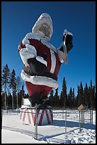 Santa Claus statue surrounded by barbed wire. North Pole, Alaska, USA (color)