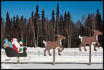 Santa Claus and reinder cut-out in winter. North Pole, Alaska, USA (color)