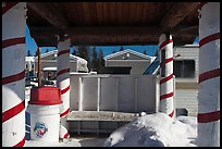 Bus stop with red candy-like stripped columns. North Pole, Alaska, USA (color)