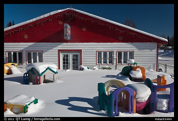 Playground in winter in front of day care. North Pole, Alaska, USA (color)