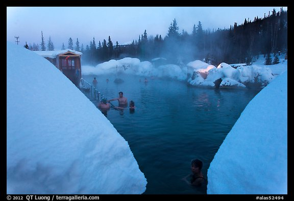 Soaking in natural hot pool surrounded by snow. Chena Hot Springs, Alaska, USA (color)