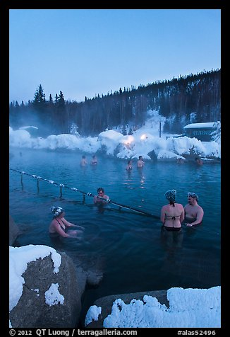 People soak in natural hot springs in winter. Chena Hot Springs, Alaska, USA (color)
