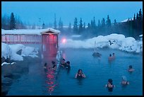Popular outdoor hot springs, winter twilight. Chena Hot Springs, Alaska, USA (color)