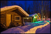 Cabins at night in winter. Chena Hot Springs, Alaska, USA (color)