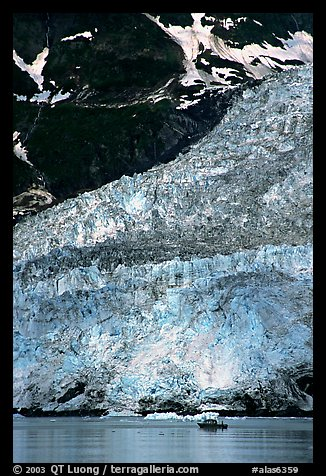 Boat at the base of Barry Glacier. Prince William Sound, Alaska, USA