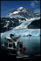 Kayakers unloading from the water taxi at Black Sand Beach. Prince William Sound, Alaska, USA ( color)