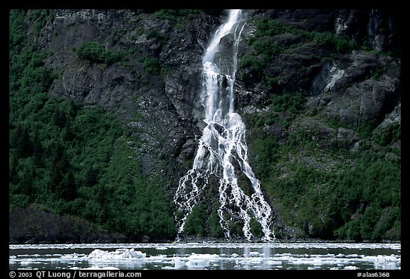 Waterfall dropping into the sea. Prince William Sound, Alaska, USA