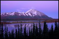 Purple mountains and lake at dusk. Alaska, USA