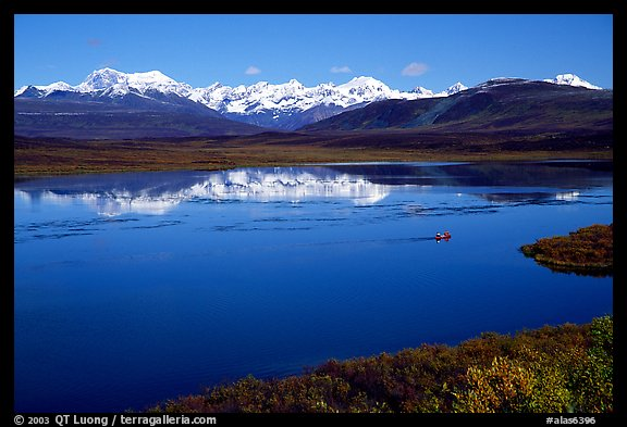 Lake with snowy peaks reflected. Denali Highway, Central Alaska, USA