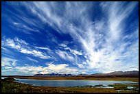 Clouds, tundra and lake along Denali Highway. Alaska, USA