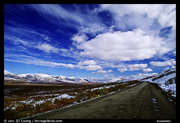 Denali Highway under large white clouds. Alaska, USA (color)