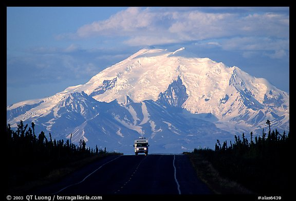 Car on Glenn Highway with Wrangell range peak behind. Alaska, USA