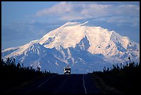 Car on Glenn Highway with Wrangell range peak behind. Alaska, USA (color)