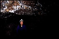 Caver inside a lava tube, Lava Beds National Monument. California, USA (color)