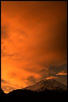 Clouds dramatically colored at sunset above Mt Shasta. California, USA